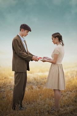 Ildiko Neer Vintage couple holding letters on field