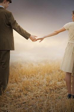 Ildiko Neer Vintage couple standing in field