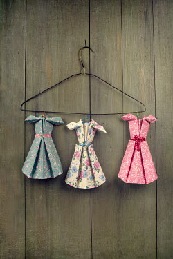 Kelly Sillaste Paper craft dresses hanging on clothes hanger