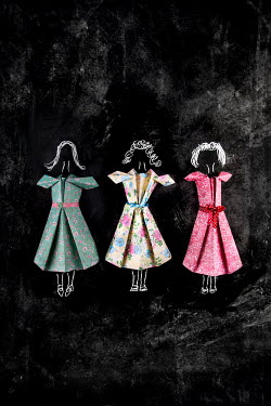 Kelly Sillaste Paper craft dresses on black background