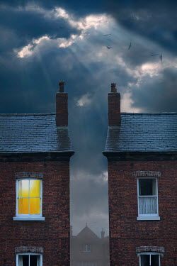 Lee Avison neighbouring houses under a stormy sky