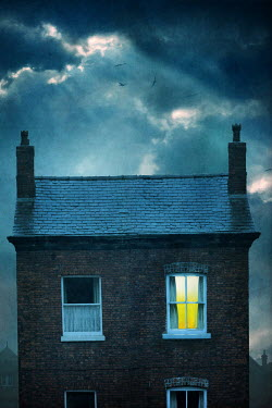 Lee Avison small victorian house at night with one bedroom window illuminated