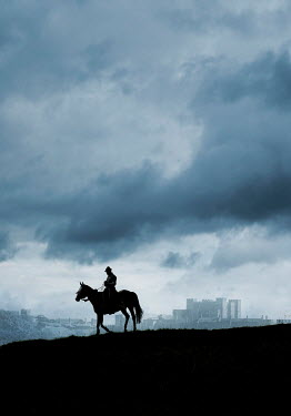 Stephen Mulcahey A silhouette of a man on a horse