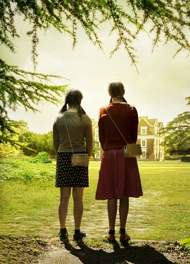 Stephen Mulcahey Two teenage girls  looking at a grand house