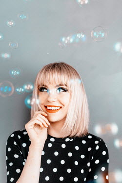 Shelley Richmond Bubbles floating by smiling young woman