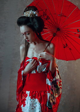 Irina Orwald Young woman in red kimono with parasol