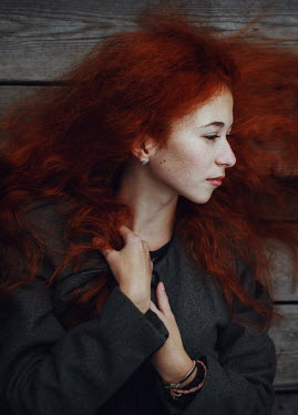 Irina Orwald Young woman with red hair lying on deck