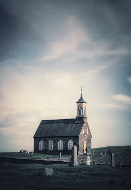 Evelina Kremsdorf Church and graveyard under clouds