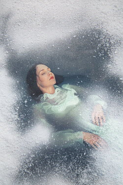 Joanna Czogala Young woman in green dress frozen in ice