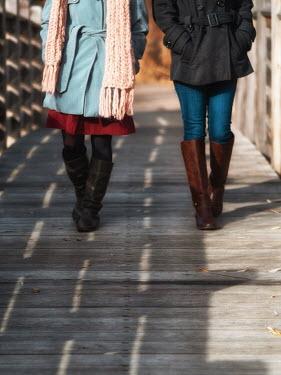 Elisabeth Ansley TWO GIRLS WALKING ON BRIDGE IN WINTER Women