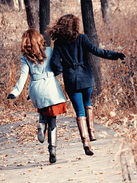 Elisabeth Ansley TWO GIRLS RUNNING IN AUTUMN COUNTRYSIDE Women