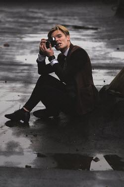 Natalia Ciobanu Young man sitting while taking photograph