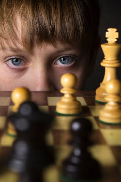 Kelly Sillaste YOUNG BOY STARING BEHIND CHESS SET Children