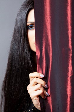 Miguel Sobreira Woman With Black Hair Behind Red Satin Curtain Women