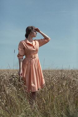 Magdalena Russocka retro woman standing in field Women
