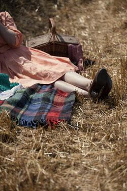 Magdalena Russocka retro woman lying on blanket in field Women