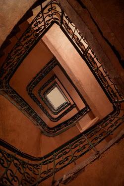 Jaroslaw Blaminsky OLD METAL STAIRCASE FROM BELOW Stairs/Steps