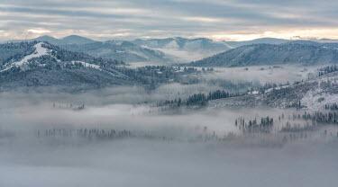 Jaroslaw Blaminsky FOGGY LANDSCAPE IN WINTER Rocks/Mountains
