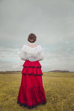 Joanna Czogala HISTORICAL WOMAN STANDING IN COUNTRYSIDE Women