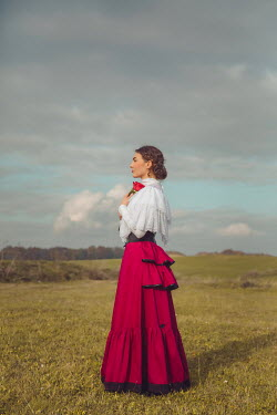 Joanna Czogala HISTORICAL WOMAN HOLDING ROSE IN COUNTRYSIDE Women