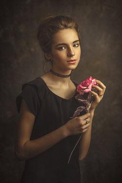 Dmytro Baev SERIOUS GIRL STANDING HOLDING PINK FLOWER Children