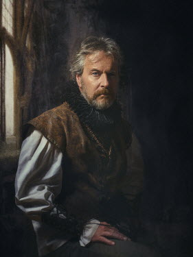Dmytro Baev SERIOUS MAN WITH RUFF SITTING INDOORS Men