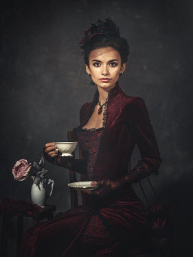 Dmytro Baev HISTORICAL WOMAN SITTING HOLDING CUP AND SAUCER Women