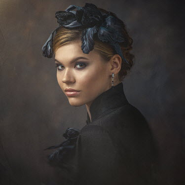 Dmytro Baev WOMAN IN BLACK WITH FLORAL HAIR DECORATION Women