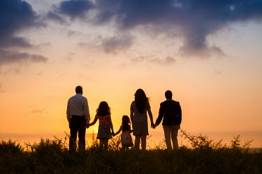 Mohamad Itani FAMILY HOLDING HANDS WATCHING SEA AT SUNSET Groups/Crowds