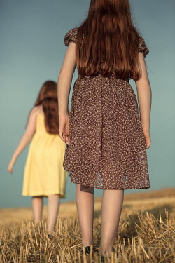 Magdalena Russocka two little girls walking in field