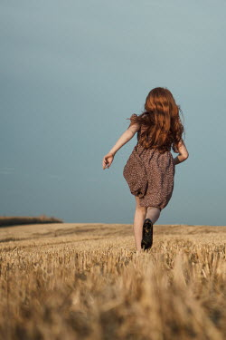 Magdalena Russocka little girl running in field