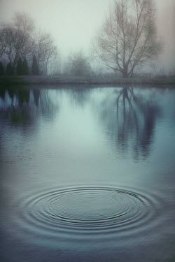 Magdalena Russocka ripples in water at misty dusk