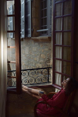 Alex Maxim WOMAN WITH DRINK BY WINDOW AT NIGHT Women