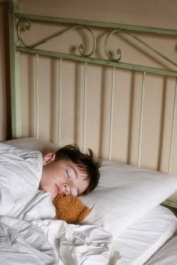 Galya Ivanova LITTLE BOY SLEEPING WITH TEDDY IN BED Children