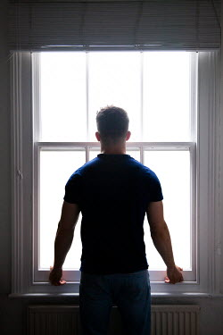 Miguel Sobreira MAN WATCHING AT WINDOW FROM BEHIND Men