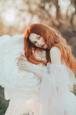 Jovana Rikalo WOMAN WITH RED HAIR HOLDING HUGE FLOWER Women
