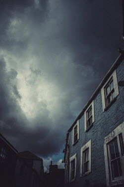 Maggie McCall STREET WTH HISTORICAL HOUSES AND STORMY SKY Streets/Alleys
