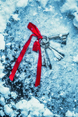Magdalena Russocka bunch of keys with red ribbon lying beneath ice