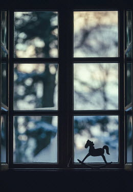 Magdalena Russocka toy rocking horse in window