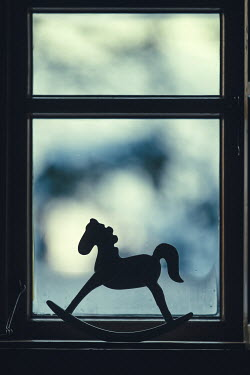 Magdalena Russocka close up of toy rocking horse in window