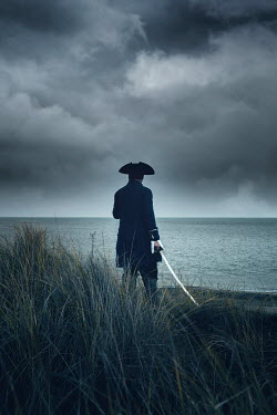 Nic Skerten HISTORICAL MAN WITH SWORD WATCHING STORMY SEA Men