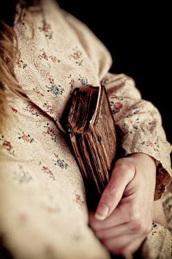 Valentino Sani CLOSE UP OF WOMAN HOLDING OLD BOOK Women