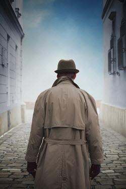 Ildiko Neer Man in overcoat standing on street