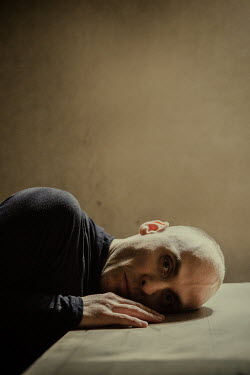 Natasza Fiedotjew Close up of sad man sitting at table Men