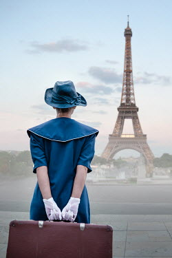 Natasza Fiedotjew Vintage woman with suitcase looking at eiffel tower Women