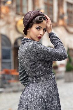 Nina Masic RETRO WOMAN WITH HAT OUTSIDE BUILDING Women