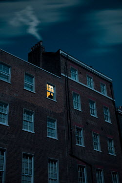 Ildiko Neer Man in window of house at night