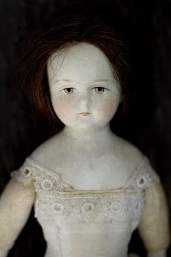 Jaime Brandel CLOSE UP OF ANTIQUE DOLL IN LACE DRESS Miscellaneous Objects
