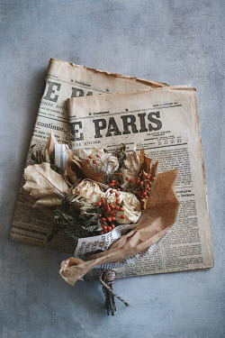 Magdalena Wasiczek french newspapers and withered  bouquet Flowers