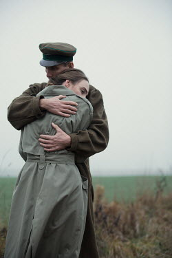 Magdalena Russocka wartime couple embracing in field